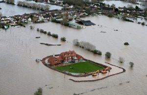 Workers build flood defences around a resident's house in the flooded village of Moorland near Bridgwater on the Somerset Levels on February 10, 2014 in Somerset, England. Source: Matt Cardy/ Getty Images